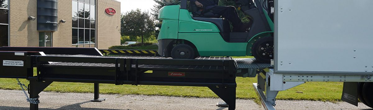 A forklift on a Copperloy portable loading ramp.