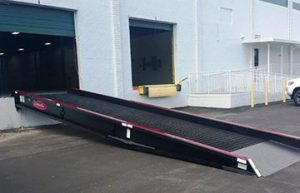 Copperloy's dock-to-ground-ramp set in place at a warehouse