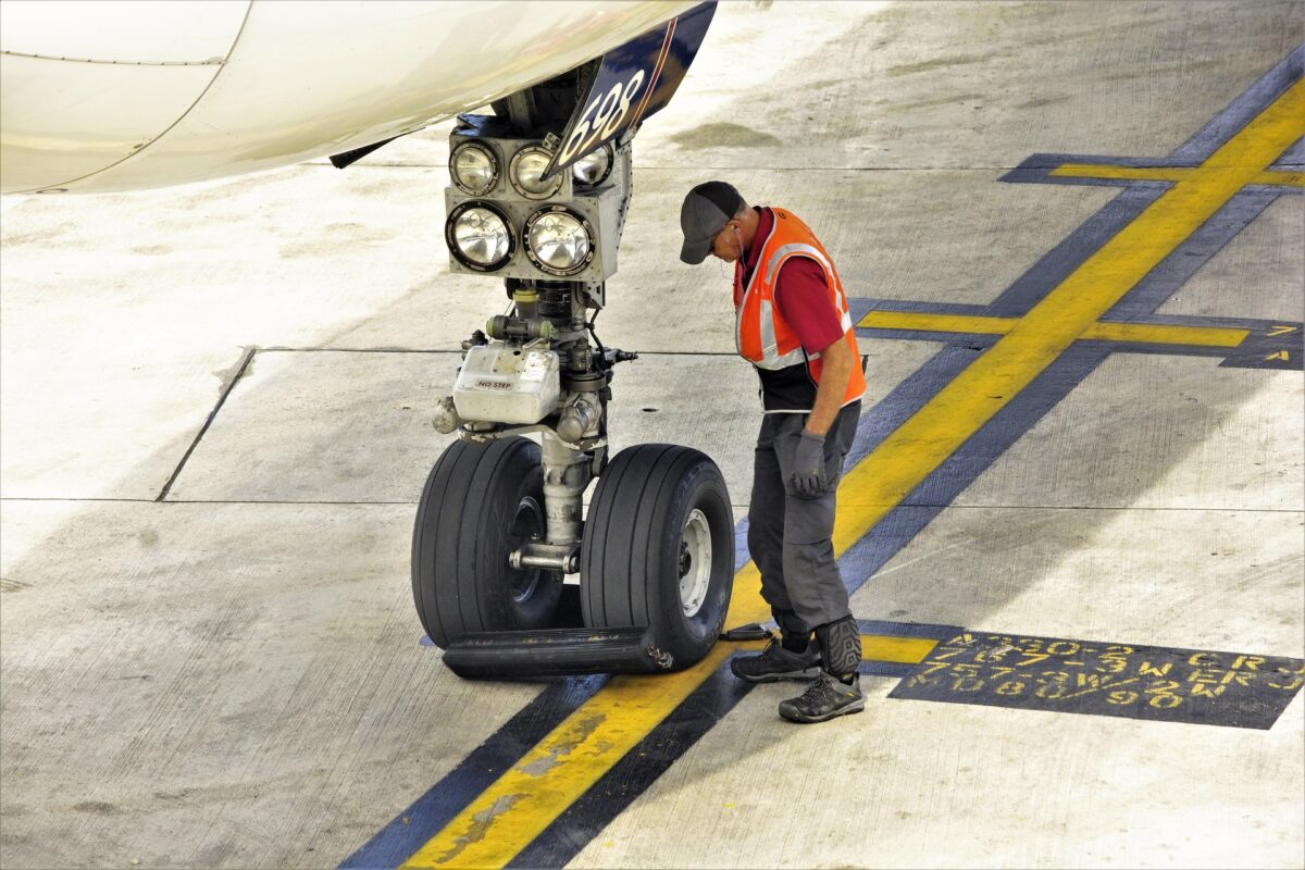 aircraft landing gear and worker